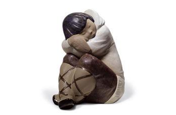 Statuetta Bimbo eschimese che riposa