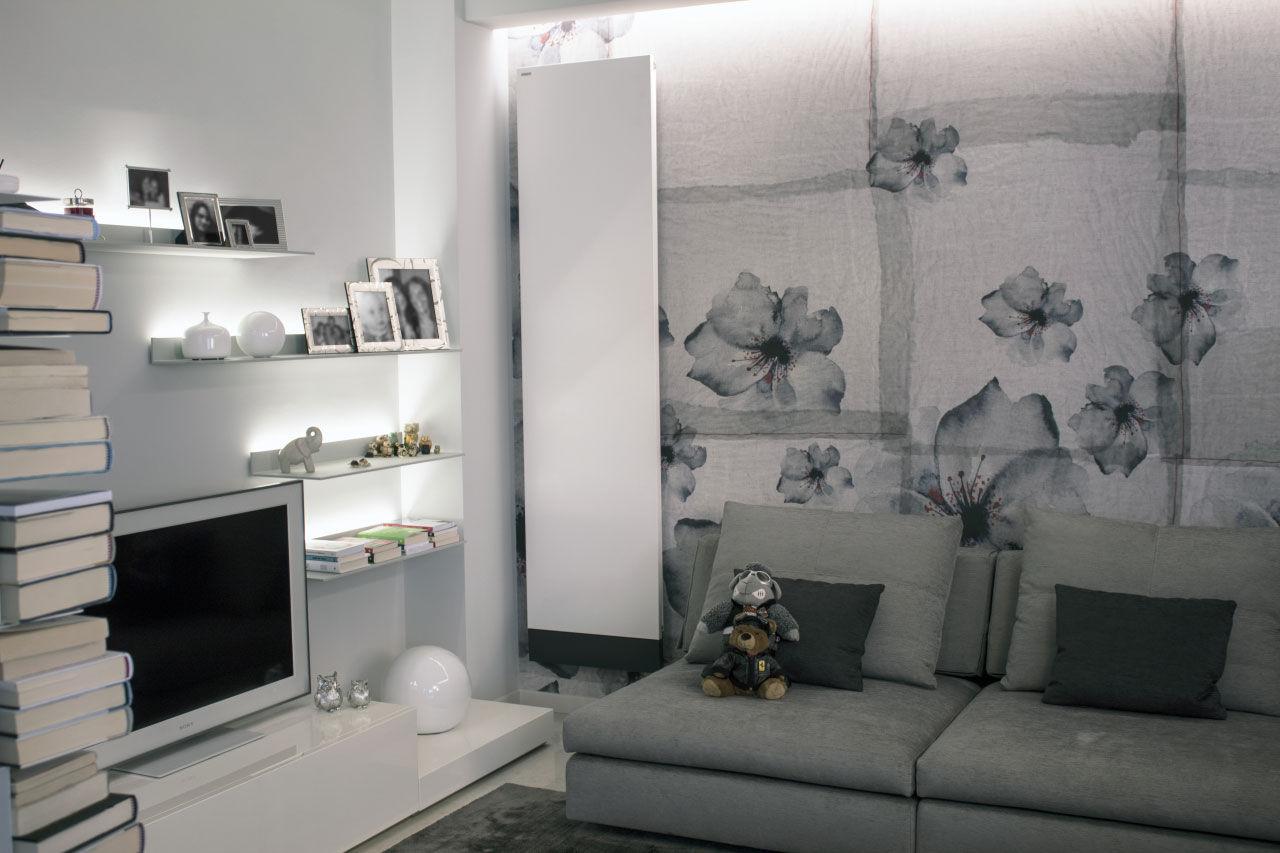 I radiatori Ti-Q e Blade diventano protagonisti di un piccolo e ricercato appartamento